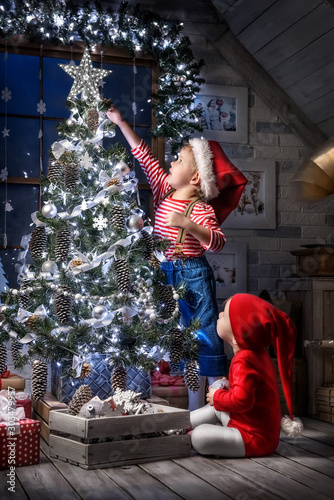 Children in the Christmas interior - 303479957