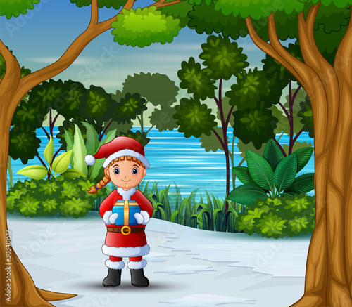 Poster Indiens A santa claus holding a box gift at winter landscape