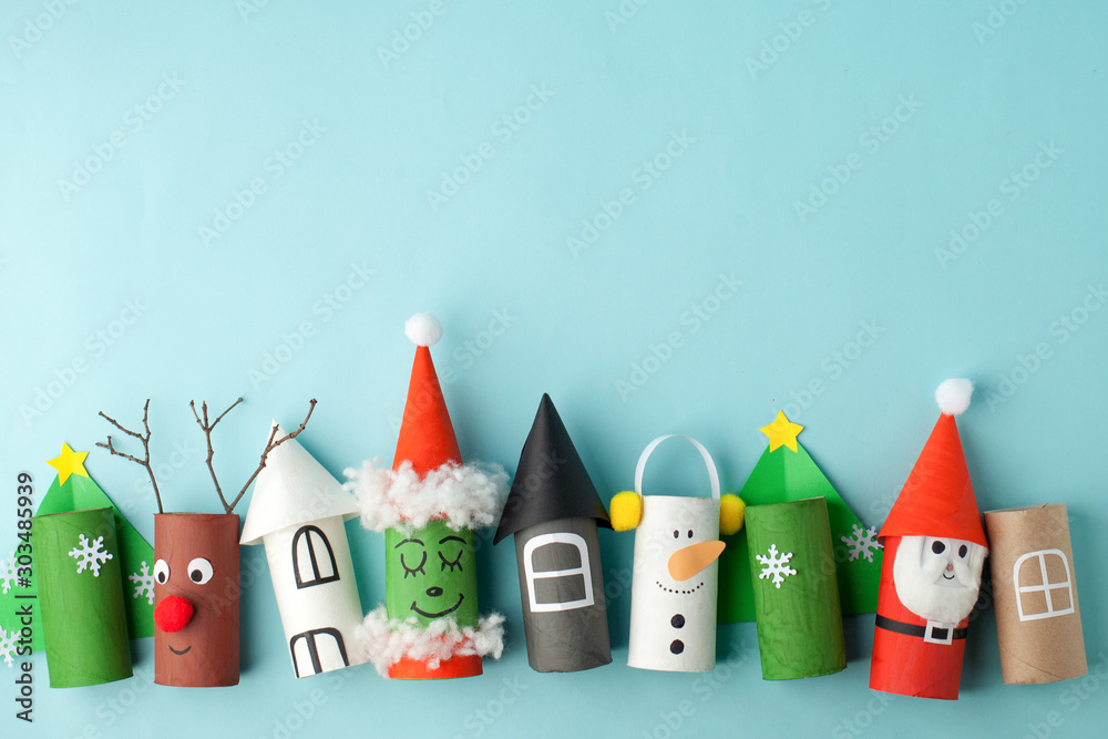 Fototapeta Paper toy Santa, Snowman, Grinch for Xmas party. Easy crafts for kids on blue background, copy space, die creative idea from toilet tube roll, recycle reuse eco concept