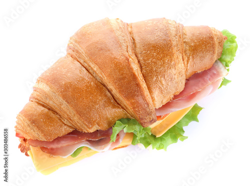 Obraz na plátně  Tasty croissant sandwich with ham and cheese isolated on white, top view