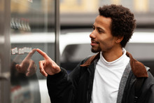 African Man Buys Drink Or Sweets At Vending Machine Outside.