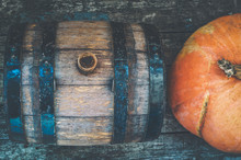 Beautiful Wooden Barrel And Pumpkins On A Wooden Table. Top View. Vintage Processing With Camera Noises, Film Grain.