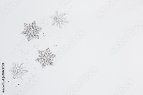 Poster Pays d Europe Christmas or winter composition. Frame made of silver snowflakes on pastel gray background. Christmas, winter, new year concept. Flat lay, top view, copy space