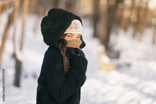 Cold winter protection Asian woman protecting skin covering nose and mouth with warm scarf - cold weather clothes accessories outdoor people lifestyle Fototapete