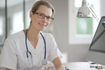 nurse facing camera in an office