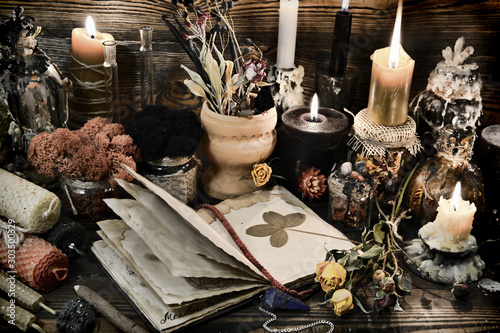 Witch table with magic objects, four-leaf clover, candles and open diary Wallpaper Mural
