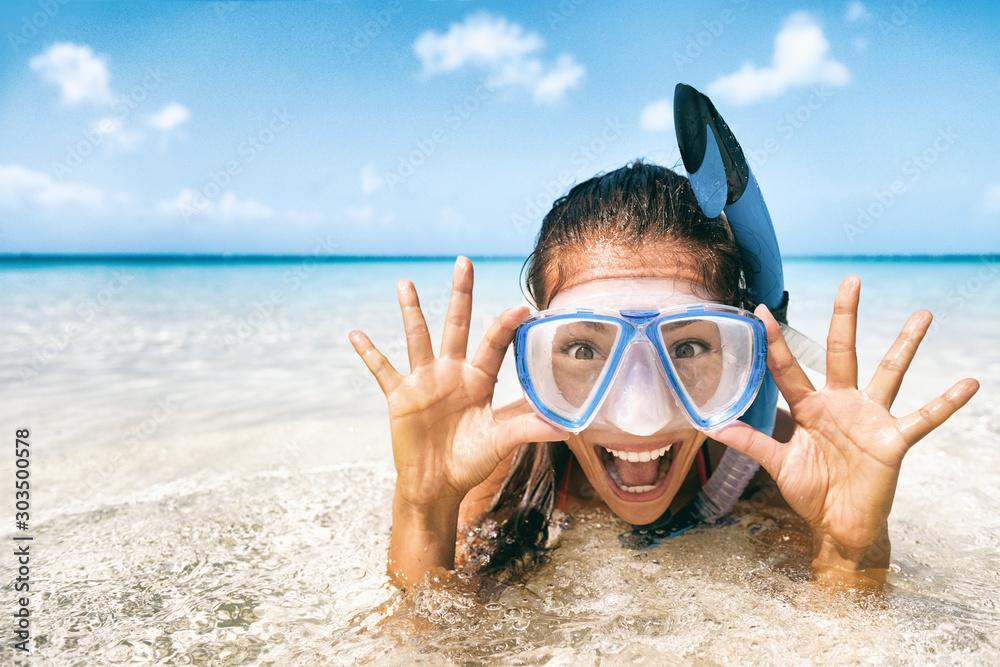Fototapeta Beach vacation tourist Asian girl swimming in scuba mask making a goofy face. Snorkel fun woman on tropical travel holidays.