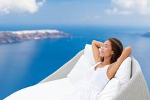 Luxury Hotel Wellness Asian Woman Sleeping On Outdoor Lounger Relaxing. Santorini Island Greece Cruise On The Mediterranean Sea.