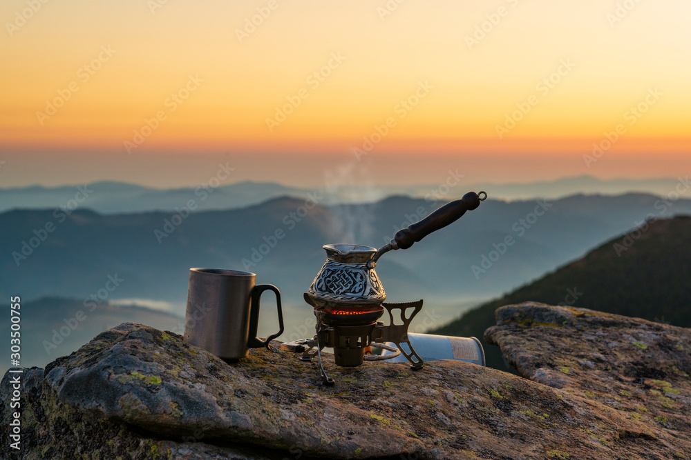 Fototapety, obrazy: Cooking Turkish coffee high in the mountains