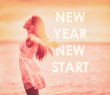 New Year Resolution Woman Feeling Free For 2020 Weight Loss Freedom Happy Girl With Open Arms On Beach Sunset. Text Writing NEW YEAR NEW START For Achieving Life Goals.
