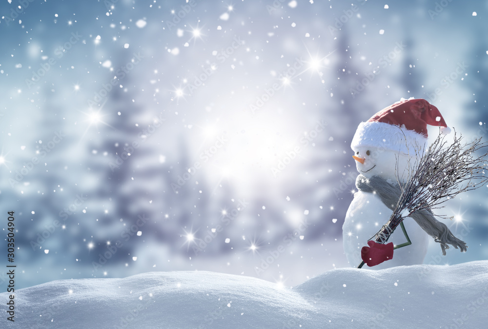 Fototapeta Merry christmas and happy new year greeting card with copy-space.Happy snowman standing in christmas landscape.Snow background.Winter fairytale.