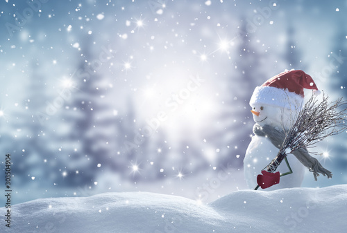 Merry christmas and happy new year greeting card with copy-space.Happy snowman standing in christmas landscape.Snow background.Winter fairytale. - 303504904