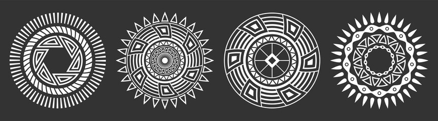 Set of four abstract circular ornaments. Decorative patterns isolated on black background.