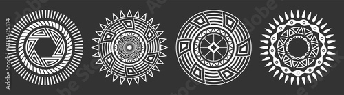 Fototapeta Set of four abstract circular ornaments. Decorative patterns isolated on black background. Tribal ethnic motifs. Stylized sun symbols. Stencil tattoo and prints Vector monochrome illustration. obraz na płótnie