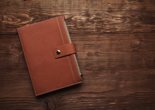 Leather Diary On A  Wooden Bro...