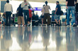 Scene of traveller with luggage reflection on floor in airport during busy hour