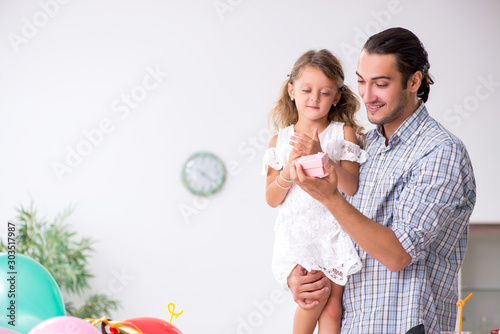 Father celebrating birthday with his daughter Wallpaper Mural