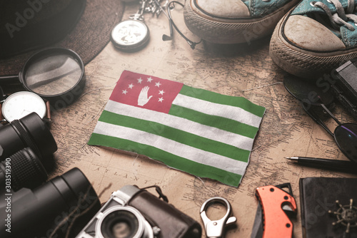 Abkhazia Flag Between Traveler's Accessories on Old Vintage Map Canvas Print