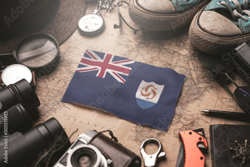 Anguilla Flag Between Traveler's Accessories on Old Vintage Map Canvas Print