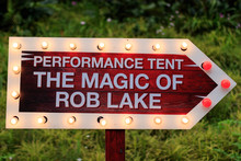 Gardens By The Bay / Singapore - DECEMBER 8, 2018: Blinking Yellow Red Arrow Pointing Signboard For Performance Tent The Magic Of Rob Lake