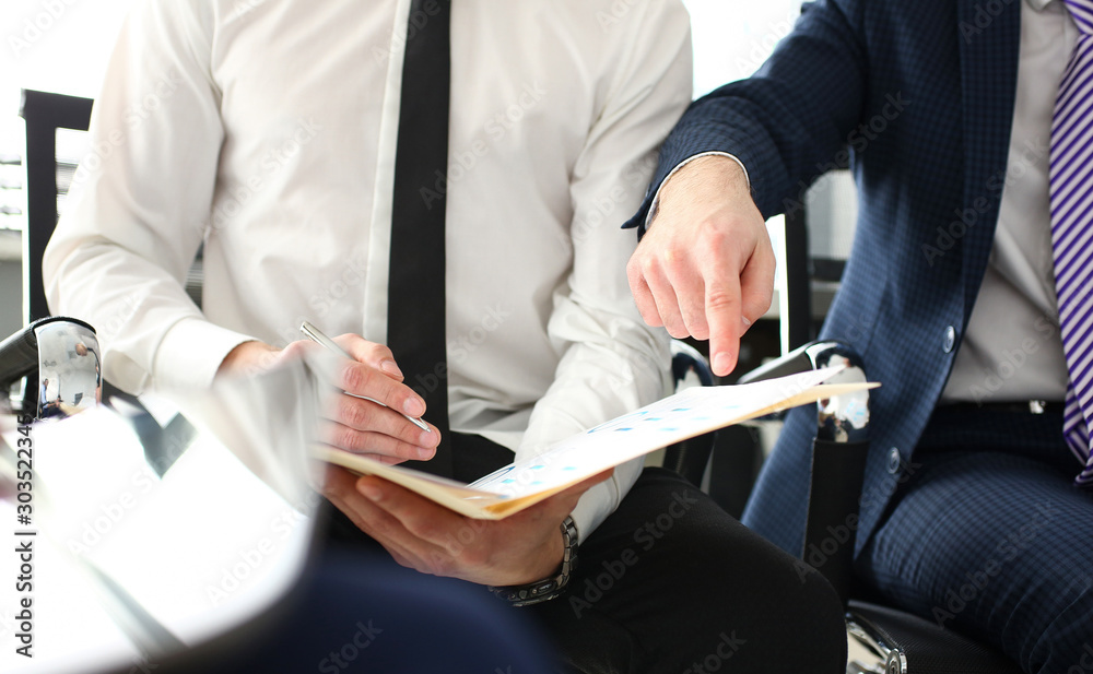 Fototapety, obrazy: Male hand in suit and tie showing something important in tax interview document