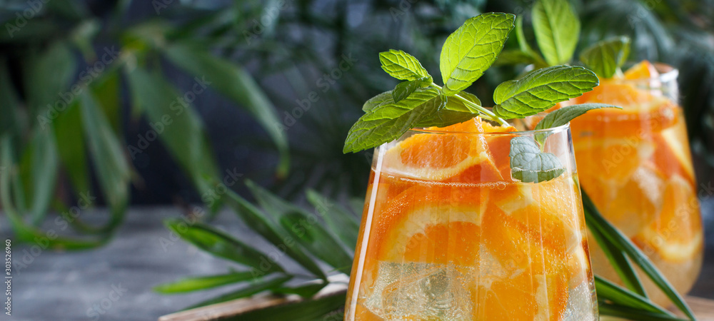 Fototapeta Homemade refreshing drink with soda and orange juice