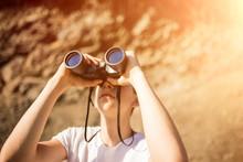 A Man Looks Through Binoculars...