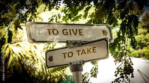 Street Sign to TO GIVE versus TO TAKE Fototapeta