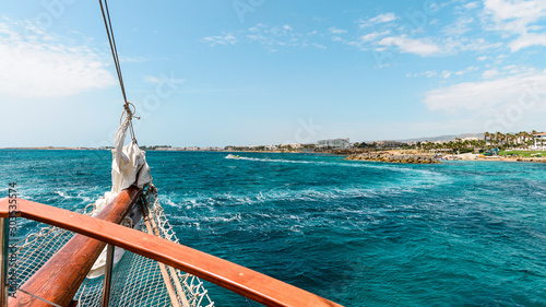 The stern of a ship with the trail in the sea in the background Fotobehang