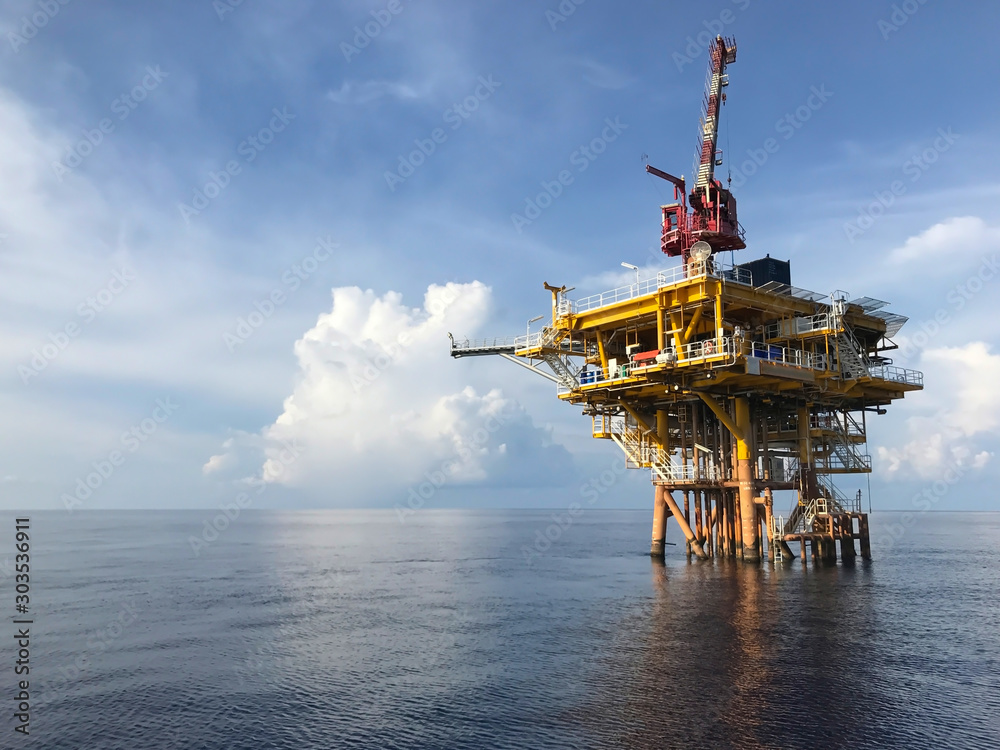 Fototapeta Oil and gas wellhead remote platform produced raw gas and oil then sent to central processing platform to separate water,gas and condensate (gas).