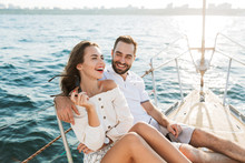 Optimistic Pleased Young Loving Couple Outdoors