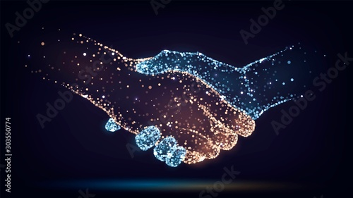 Two hands of glowing particles, orange and blue, handshake,  business, trust con Canvas Print