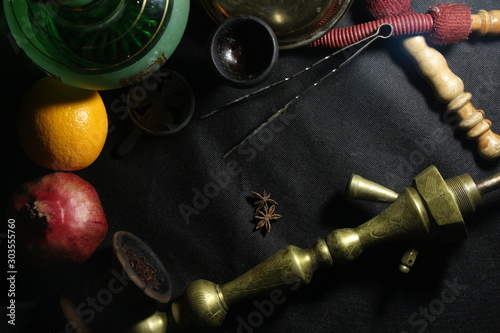 Fototapety, obrazy: bowl with tobacco for hookah. fruits on a black background. smoking hookah