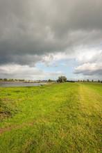 Dark Clouds Above A Wide Dutch...