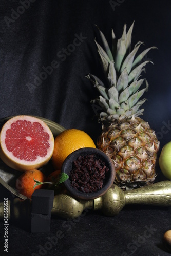 bowl with tobacco for hookah. fruits on a white background. smoking nargile