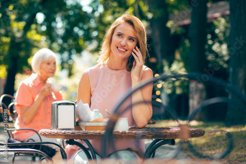 Pleasant phone talk with best friend stock photo #303563198