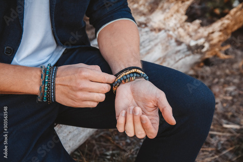 Cuadros en Lienzo Hands of man with bracelets on both hands