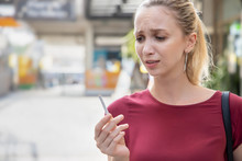 Determined Woman Trying To Quit Smoking And Breaking Her Cigarette, Concept Of No Smoking, Stop Smoking, Health Care, Healthy Lifestyle Without Tobacco And Cigarette