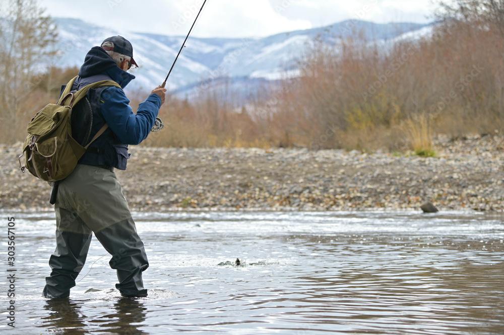 Fototapety, obrazy: River fly fisherman in Montana