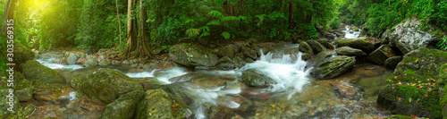 Panoramic beautiful deep forest waterfall in Thailand - 303569315