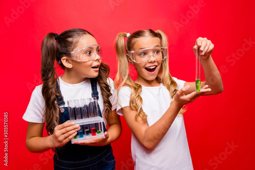 Fotografie, Obraz Photo of two funny small ladies diligent school kids make chemical experiment ex