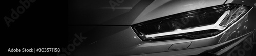 Fototapeta Close up detail on one of the LED headlights modern car.copy space,black and white obraz