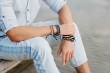 Hands Of Man With Bracelets On Both Hands. Place For Text Or Advertising