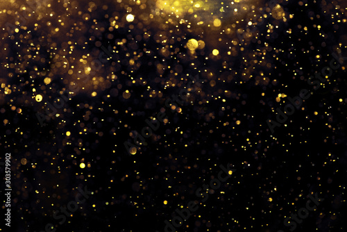 Obraz golden glitter bokeh lighting texture Blurred abstract background for birthday, anniversary, wedding, new year eve or Christmas - fototapety do salonu