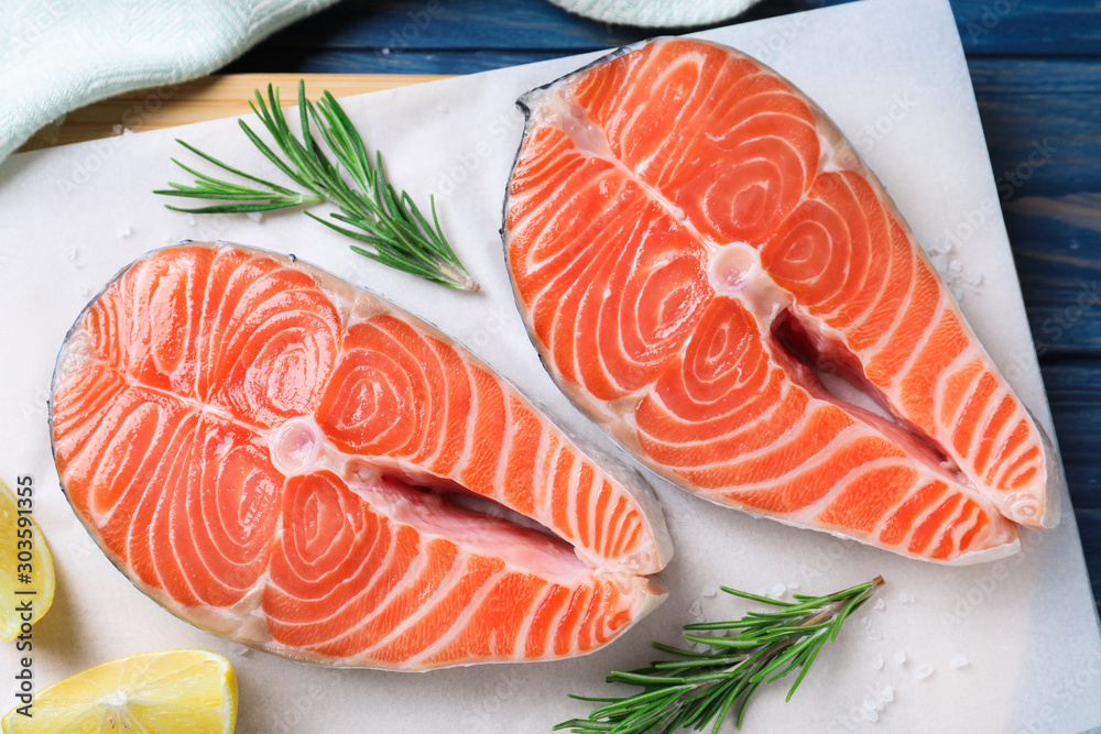 Fototapety, obrazy: Fresh raw salmon with lemon and rosemary on parchment, flat lay. Fish delicacy