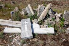 Broken Stone In A Cemetery Lie...