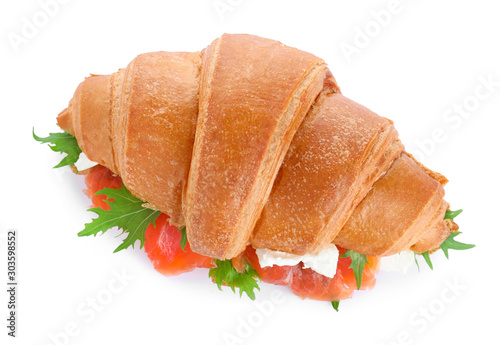 Fotografie, Obraz  Tasty croissant sandwich with red fish isolated on white, top view