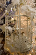 Christmas Decoration - White Bird Cage And On It White Birds With Feathers, Butterflies And Silver Swan.Snowflake, Many Birds With Feathers, One Swan And Bird Cage. White And Gold Christmas Combinatio