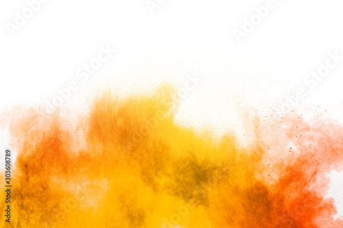 Papel de parede Abstract yellow orange powder explosion on white background