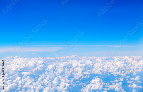 Sky and clouds beautiful The view out of an airplane in the morning appropriate the background , idea copy space - 303610348